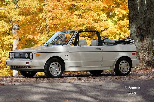 white VW Cabriolet convertible, ours is lowered and has rims,, but could do with some love too.