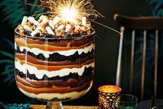 Jamie Oliver's take on the festive trifle is an epic jam of chocolate mousse, marshmallow, brownie, cream and popcorn.