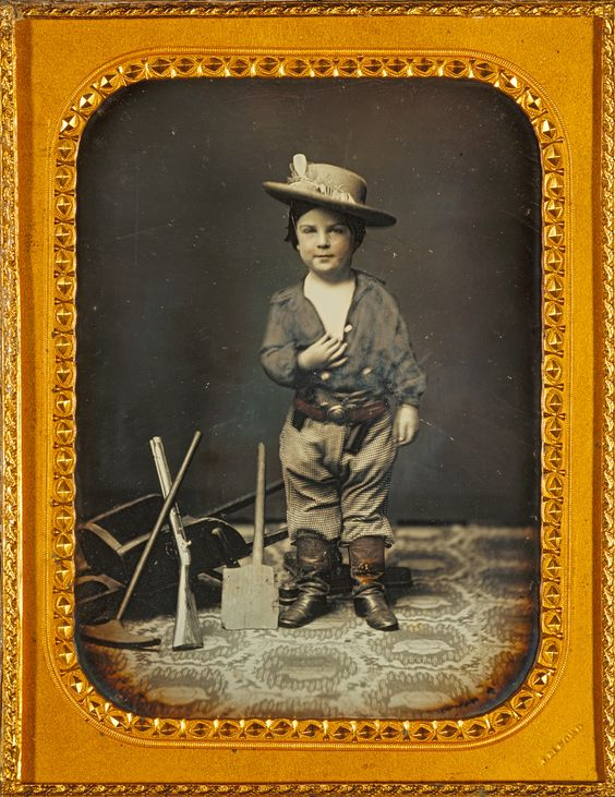 Portrait of a Boy with Gold-Mining Toys; Carleton Watkins (American, 1829 - 1916), James M. Ford (American, 1827 - about 1877); March - September 1854; Daguerreotype, hand-colored; 11.3 × 8.3 cm (4 7/16 × 3 1/4 in.); 84.XT.406.1; J. Paul Getty Museum, Los Angeles, California: