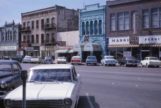 Vintage Austin - unfortunately most of the buildings in this photo have been bulldozed. The blue one is a Quik Print copy shop and  half of the brown Massey's furniture is a bar called Speakeasy.