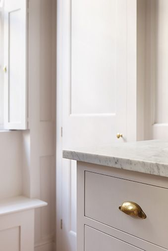 flush inset doors and marble tops w/ brass hardware
