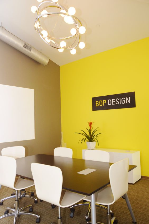 conference room with an orange accent wall at the central