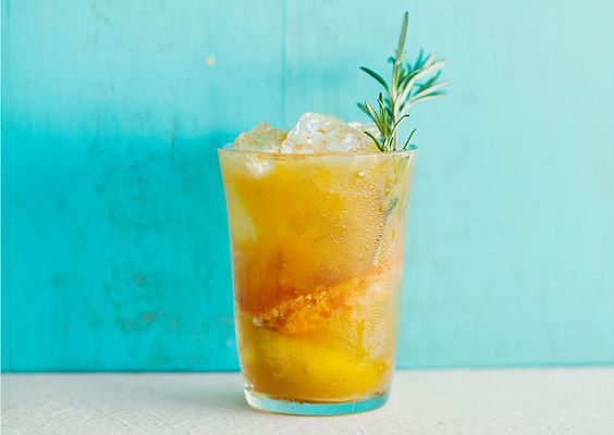 Rosemary Tangerine Cooler: Adding sugar-coated tangerines seared over rosemary sprigs turns this rum-based refresher into a revelation.