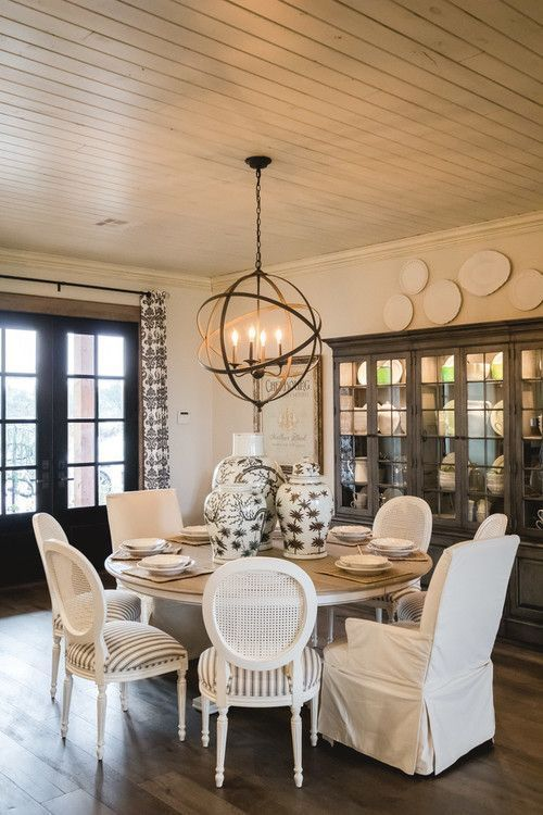 Modern Farmhouse Dining Room With Round Wooden Table And Round Cain Back Di Modern Farmhouse Dining Room Farmhouse Dining Room Lighting Modern Farmhouse Dining
