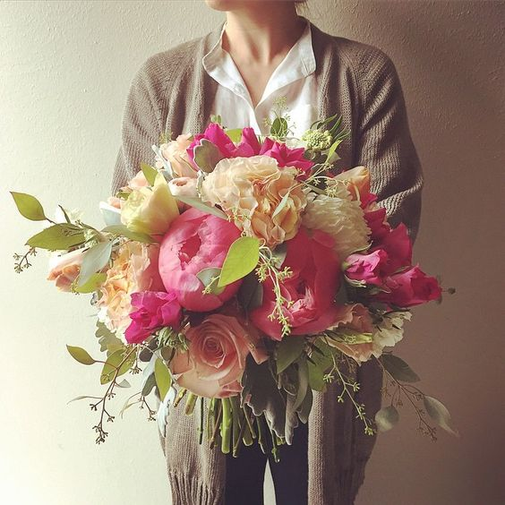 Coral charm peonies, seeded eucalyptus, dusty miller, and garden roses bouquet