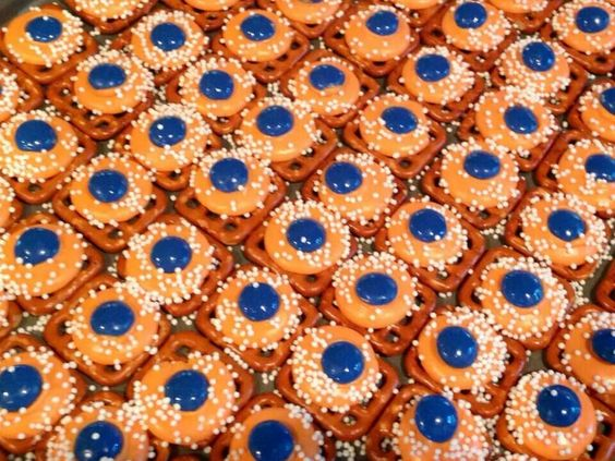 Auburn pretzel candies :) Melted white chocolate with orange food coloring and a blue m&m!