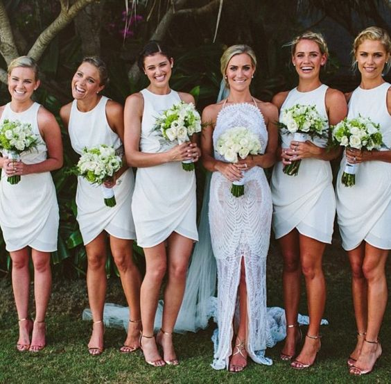 White bridesmaids in short gowns with nude heels. Love the high