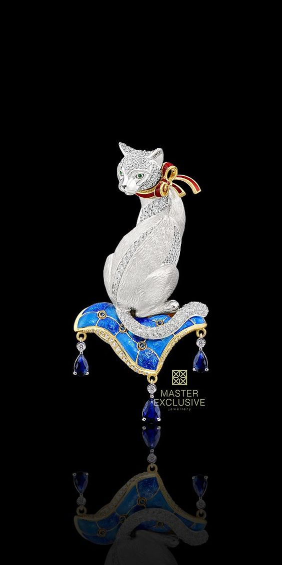 Cat brooch, with Ruby bow and sitting on enamel pillow: