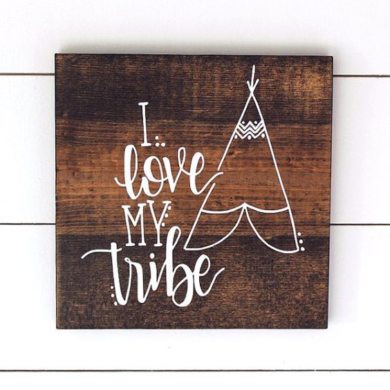 """I love my Tribe"" Adorable stained wood piece with white lettering and hand sanded edges. SIZE: 11.25″ x 11.25″ ___________________  This piece is ready-to-ship. These signs are made using first generation White pine board and is stained in the MillionAyres Signature Walnut. All lettering and illustrations are hand lettered and hand drawn then converted to a stencil and painted using Acrylic Paint. It is then sealed with a clear matte enamel/polyurethane to ensure a long and vibrant life…"