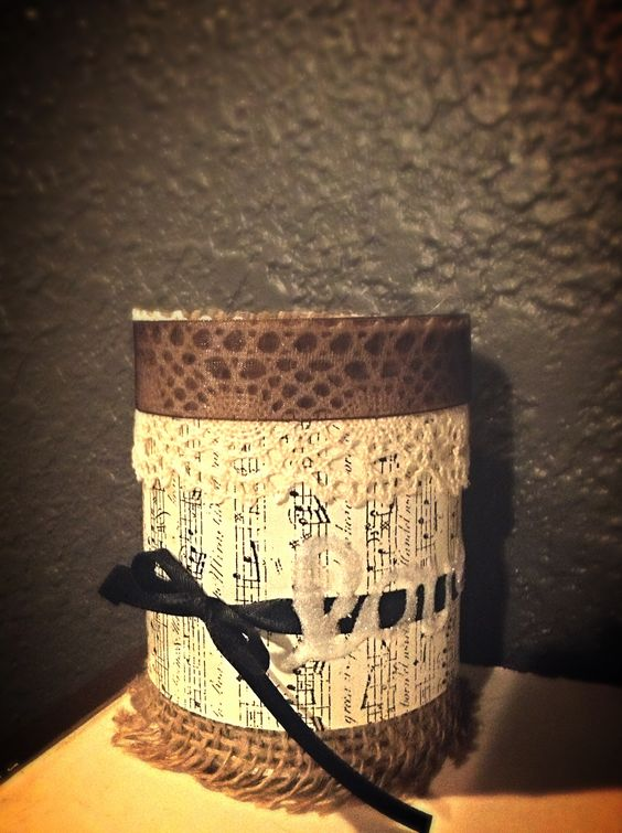 "Shabby chic decorated tin can. ""Love"" written in glitter on the side. Going to use it for pens and pencils :)"