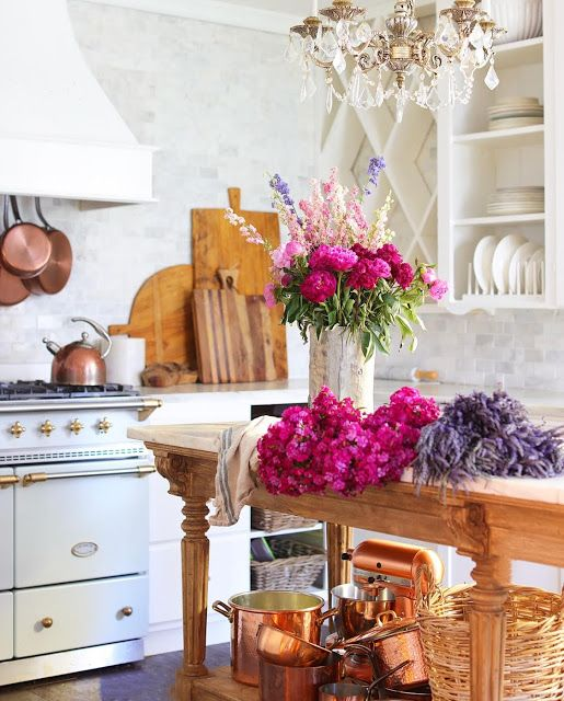 I adore copper pots—rustic, vintage, and so charming in the French country kitchen! On the blog, I'm sharing my French country kitchen style and a copper pots giveaway! #frenchcountrycottage #copperpots #vintagekitchen #vintagestove