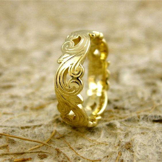 Art Nouveau Style Wedding Band with Curly Leaf Pattern in 14K Yellow Gold 5 mm Wide Size 5.25 Glossy Finish. $785.00, via Etsy.