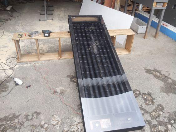 r alisation d 39 un chauffage solaire a aire avec des canettes de coca avec un petit ventilateur. Black Bedroom Furniture Sets. Home Design Ideas