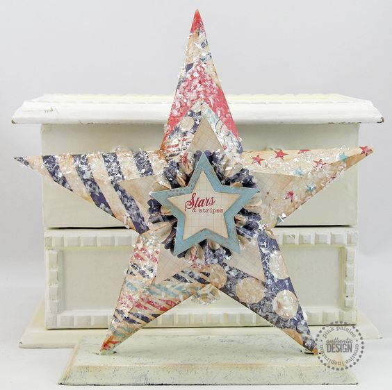 I made this star project using fun patterned paper from the Pink Paislee Declaration collection.  Thanks for looking :)