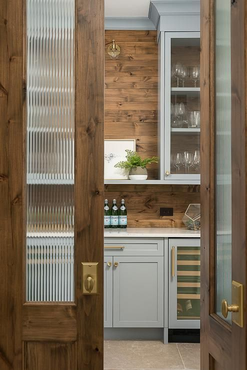Rippled Glass Panels Accent Wood Bi Fold Doors That Open To Reveal A Kitchen Pantry Boasting Blue Farmhouse Kitchen Design Dining Room Renovation Pantry Design
