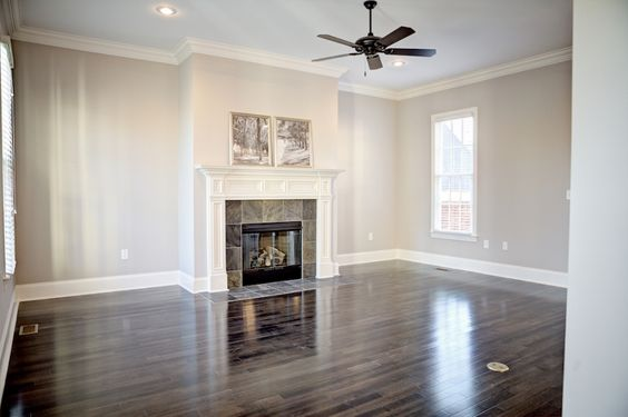 Living room dark floors white trim light brown grey for Light brown wall color