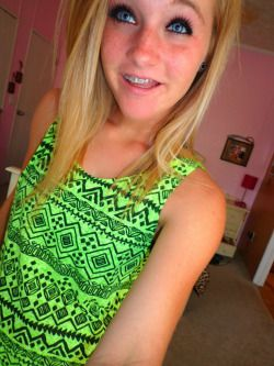 We Love That Tribal Top And Her Terrific Braces Smile http://girlswithbraces.co/post/119769492837/neon-tribal