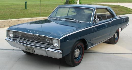 our green 1967 Dodge Dart similar to the one pictured here. My mom corrected me on this....I thought it was a Plymouth Valiant (same difference).