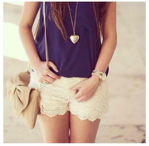 A simple blue shirt with a little ruffles, cute white shorts, a ...