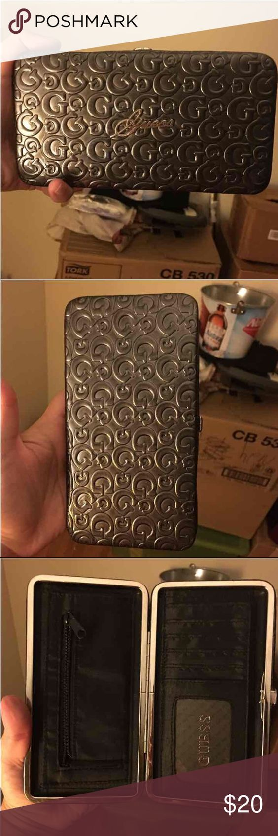 """NWOT Guess Wallet clutch Just bought this off of this app and received it today but found it has no place for my checkbook Many slots for cards, zippered pocket, and 2 pockets on either side No flaws, never used Dark gray with """"G"""" logo scroll on it and silver Guess emblem on front So cute wish I could use it Smoke and pet free home Asking for what I paid for it FREE SHIPPING!  Check out my closet for more great items BUNDLE AND SAVE....ask me how! Thank you for stopping by Guess Bags Wallets"""