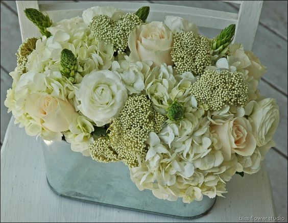 …hydrangeas, Star of Bethlehem, ranunculus, 'Vendela' roses and rice flower in a galvanized oval tin…