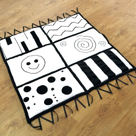 A soft, velour mat. The bold images and patterns are designed to engage with really young children. Research informs us of the benefits of having such stimulating images. As well as providing a cosy surface there are also ribbons around the edge to manipulate. £38.34inc VAT