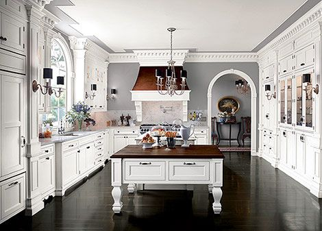 same kitchen with sconces - different view, second island; this kitchen is bigger than my living room and dining room together!