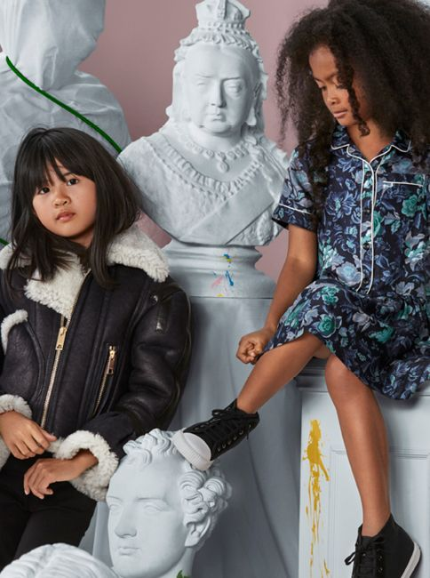 Runway-inspired styles in pocket-sized proportions. The childrenswear collection includes a sculptural shearling flight jacket and printed silk designs.