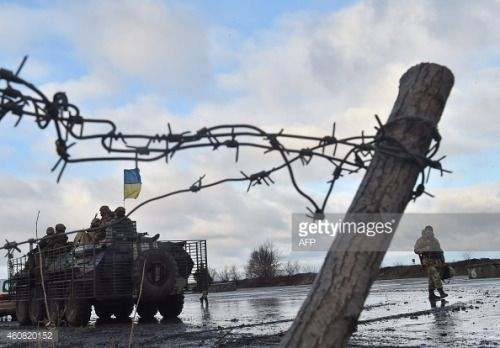 Ukrainian soldier walks near their armoured personnel carrier at... #kramatorsk: Ukrainian soldier walks near their armoured… #kramatorsk