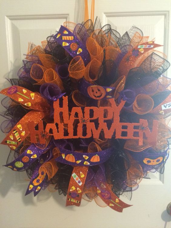 Mesh Halloween Wreath. I couldn't find ribbon that suited young children so I bought wide, wired plain orange and purple ribbons and decorated the ribbon myself.