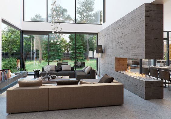 In my dream house, there is a fireplace in the living room and there are armchairs and large windows.