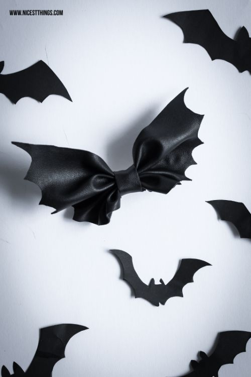 DIY Bat Bow Tutorial from Nicest Things.Make this Halloween DIY Bat Bow from leather or pleather.This site is in German but there is a translate button and also a good illustrated tutorial.