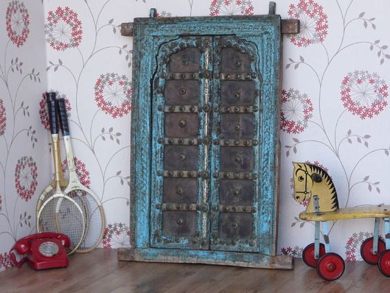 Magnificent grand hand carved antique wooden window frame and shutters from India. This magnificent old window has been reclaimed from an old house in north west India, probably Rajasthan / Gujarat. Made by highly skilled traditional craftsmen these hardwood frames and shutters show wonderful intricate carved detail and authentic gradual aging and a great patina. £325