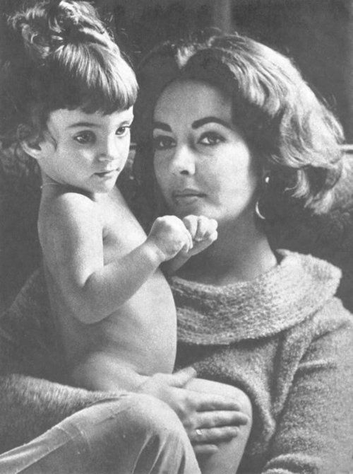 Elizabeth Taylor with her daughter, Liza Todd. She's like a mini me its freaky