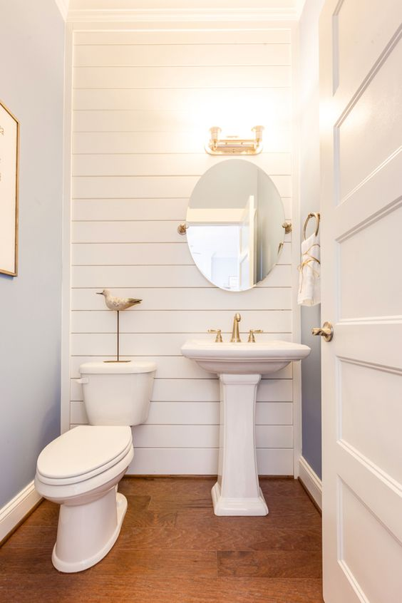 Coastal powder bathroom with shiplap wall bathroom love for Small half bathroom designs