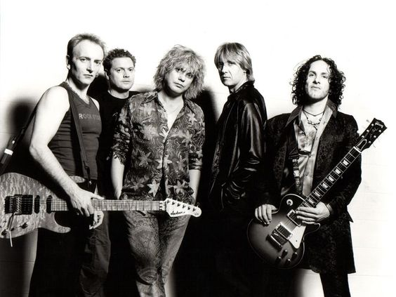 Def Leppard are an English rock band formed in 1977 in Sheffield as part of the New Wave of British Heavy Metal movement. Since 1992, the band have consisted of Joe Elliott, Rick Savage, Rick Allen, Phil Collen, and Vivian Campbell. wem