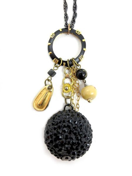 """Black & gold watch bezel, large studded black ball, hand painted ceramic beads, square onyx bead, gold & mixed metal chain. Chain - 32"""""""