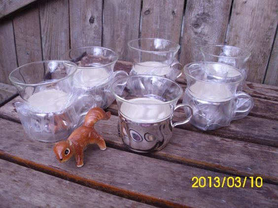 Vintage Jena Glass-Schott Maine-Clear Glass Punch/Coffee/Tea Cups With Silver Metal Holders-Unused. $25.00, via Etsy.