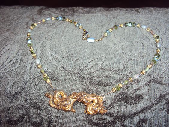 """VIntage Dragon Pendant from my mother's jewelry collection.  Re-strung necklace with 14ktgf """"Liqui Gold"""", genuine freshwater pearls, peridot, crystal and faceted moss agate.  One small blue lace agate faceted pillow at clasp."""