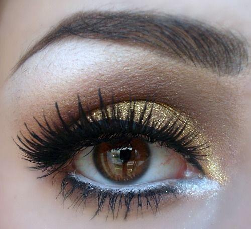 Gold glitter eye shadow.