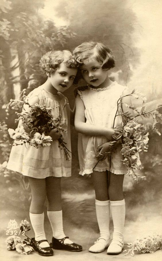 two girls looking sweet in their cotton frocks and Mary Janes
