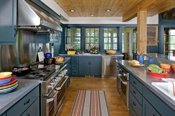 Cabin kitchen with blue green cabinets  Cabin Life magazine  Photo