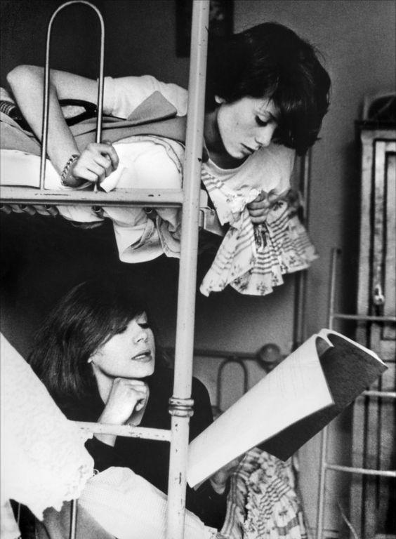 Catherine (Deneuve) and Françoise Dorléac lounge in their bunk beds.