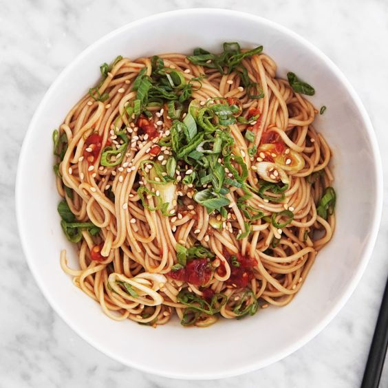 You know what they say: sun's out, cold noodle salads out. This easy, chilled soba noodle salad with a spicy-nutty sauce is ready.
