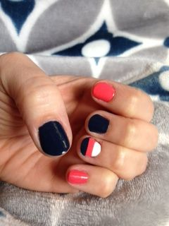Navy, coral and stripe nails