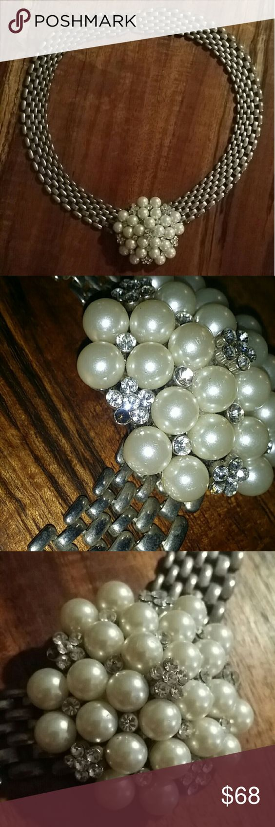 Vintage Large Pearl/Crytal Statement Necklace Beautiful Vintage Necklace set in a silvertone setting. Gorgeous piece for any special occasion! Missing a stone as seen in pic #2 otherwise, its in excellent vintage condition.  Missing stone can easily be replaced or wear as is. Not noticeable when wearing unless your looking for it. Jewelry Necklaces