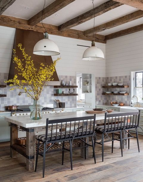 A modern farmhouse kitchen with rustic beams, shiplap, barn style pendant lights and benches at island. #modernfarmhouse #kitchendesign #rusticdecor Jennifer Bunsa design
