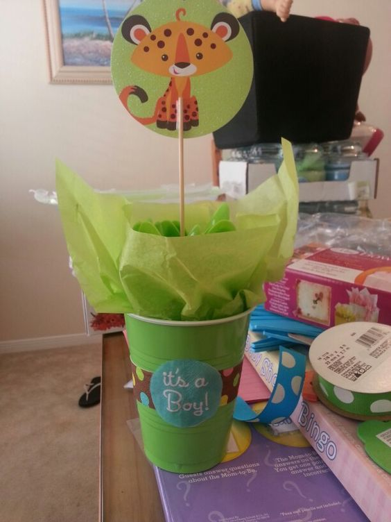 CHEAP centerpiece :)  plastic cup filled with tissue paper and utensils, attach a picture from your theme to a kabob stick and stick it in the center :) woot woot!!