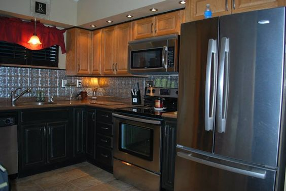 distressed black kitchen cabinets black stainless steel and solid surface countertops on 6779