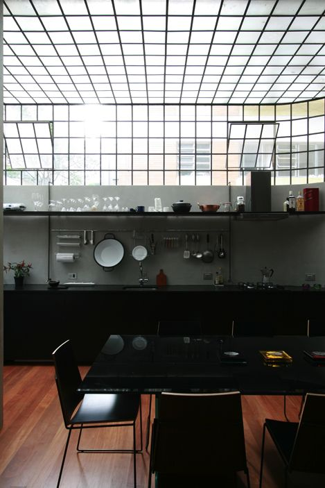 black + grey kitchen w/ factory windows [loft cinderela by Brazilian architects AR Arquitetos]